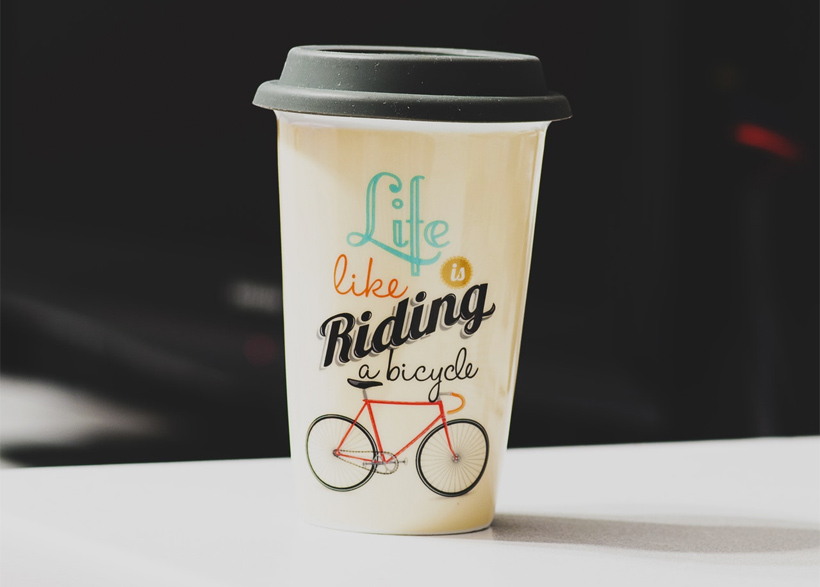 rinted paper coffee cup featuring a bicycle image
